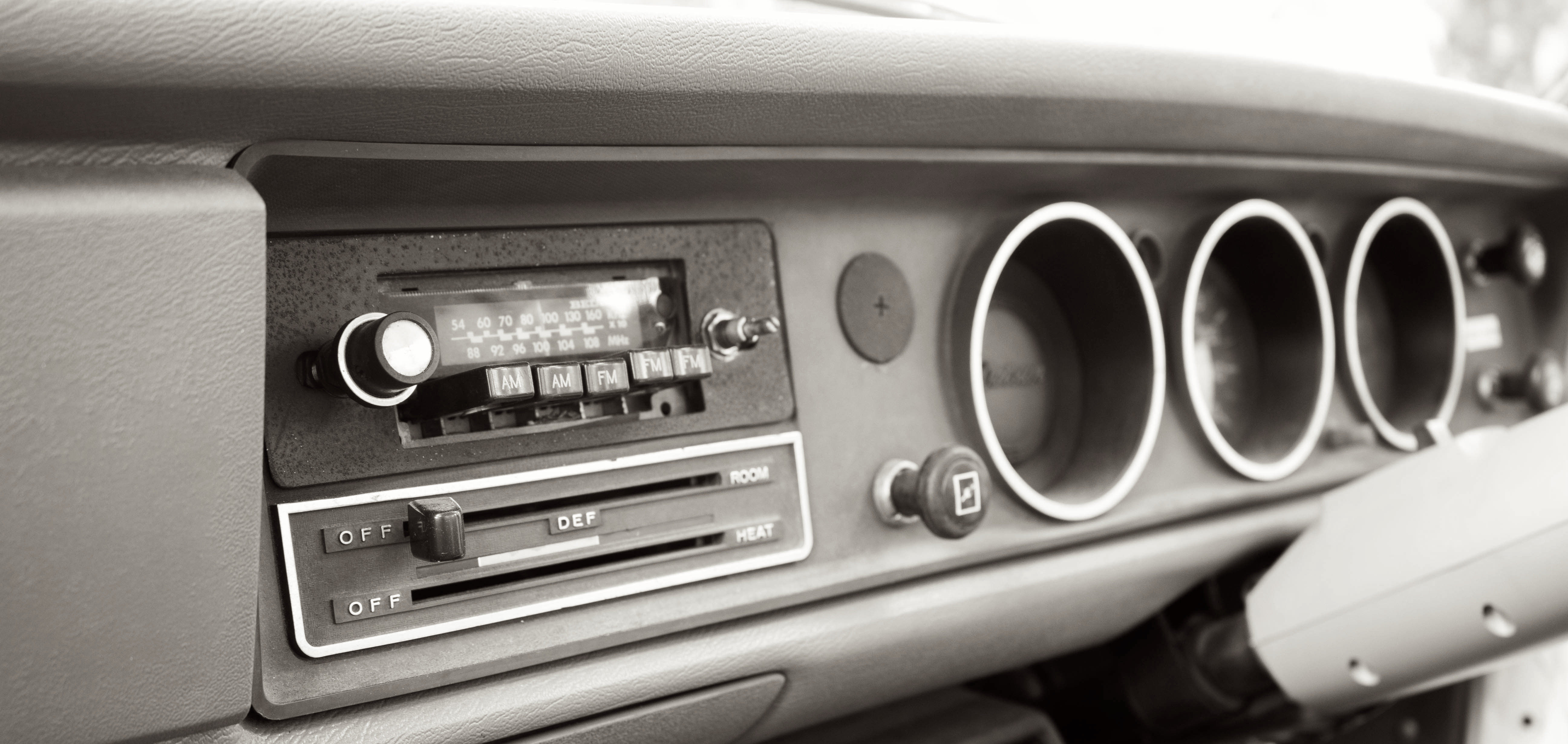 Dashboard for an old car, showing old style radio buttons